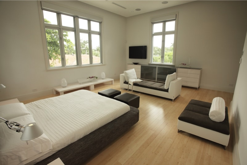 bed and furniture and stunningly set against a light hardwood floor