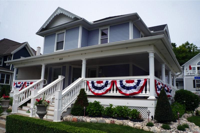 A Victorian era mansion with wraparound porch on Main Street