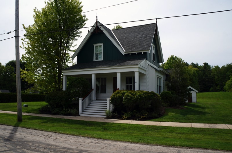 Small Harbor Springs Home with a grand set of wooden front steps