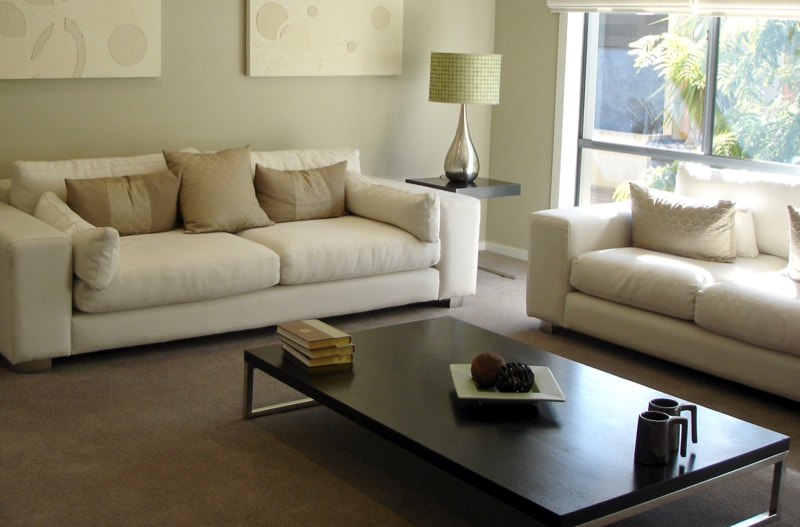 Contemporary Living Room With White Sofas And Contrasting Low Height Black Coffee  Table