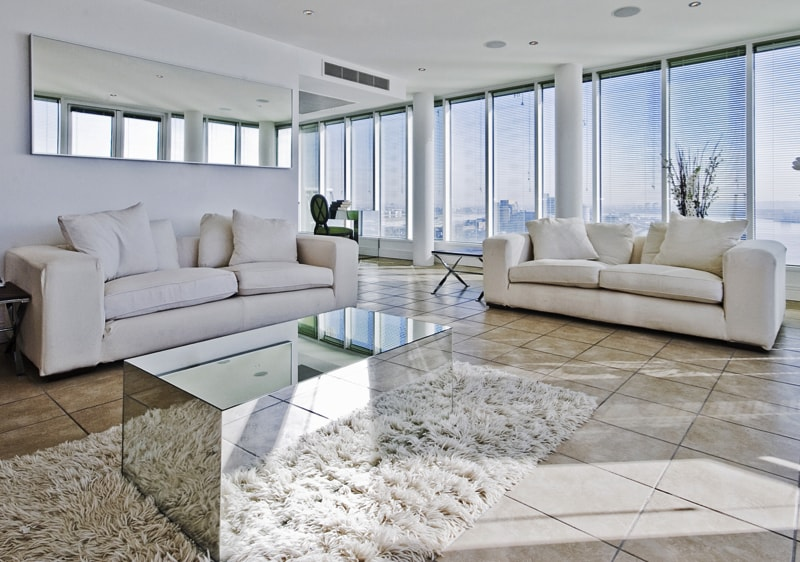 Spacious Penthouse Living Room With Mirror Glass Coffee Table
