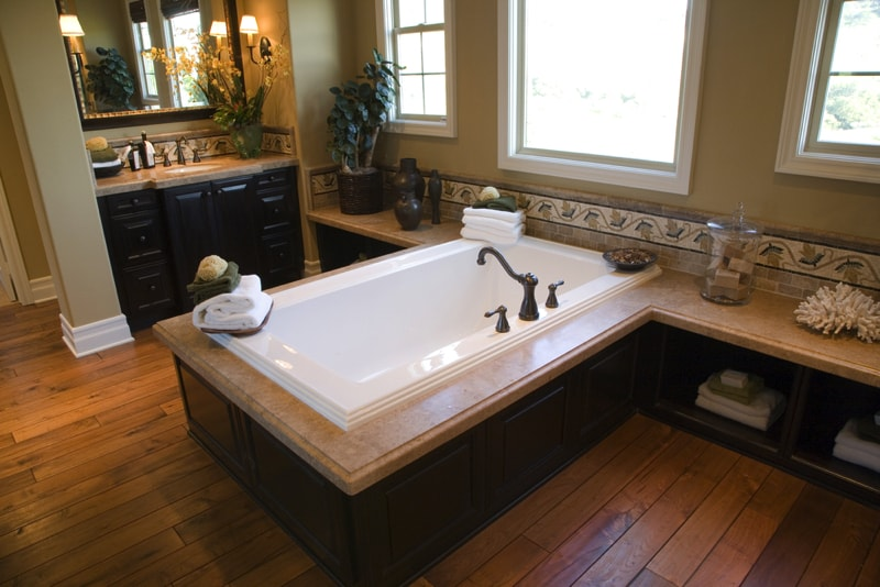Hardwood Floor In Bathroom reclaimed white oak hardwood flooring in the bathroom Luxurious Bathroom With A Modern Central Bath Tub And Hardwood Floor