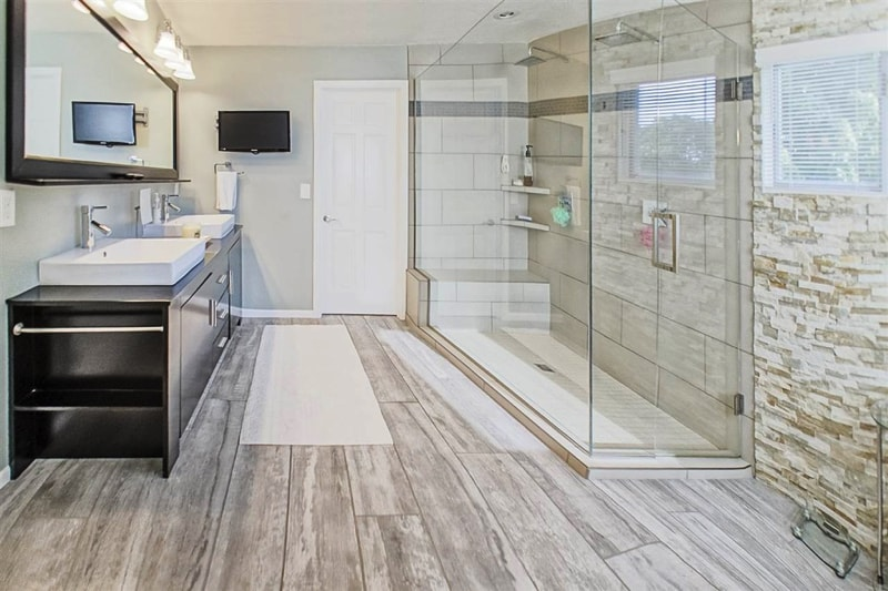 Hardwood Floor In Bathroom white bathrooms with wood floors hd photo Bathroom With Feature Block Wall Large Shower And Laminated Hardwood Flooring Via Zillow