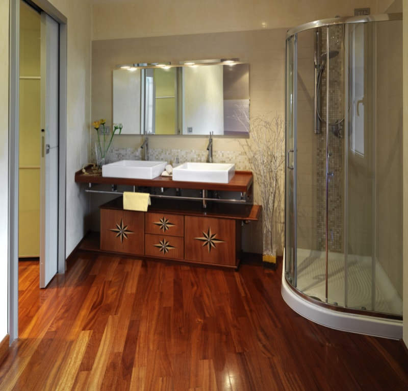 Luxurious modern bathroom with shower cubicle and wood floor