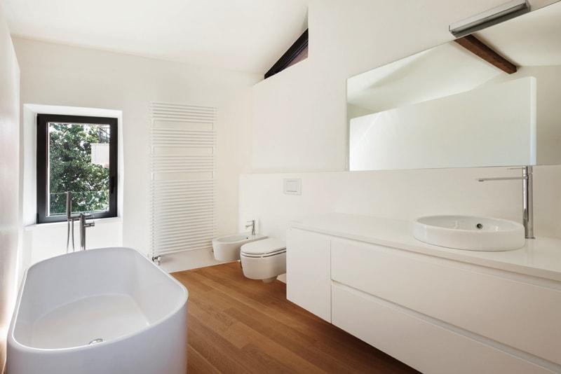 1 modern loft bathroom with bathtub min - Contemporary Loft Conversions
