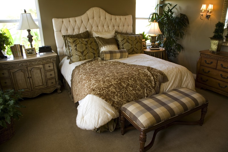 A Decorated Master Bedroom With Antique Style Furniture And Luxury Bed Soft Furnishings