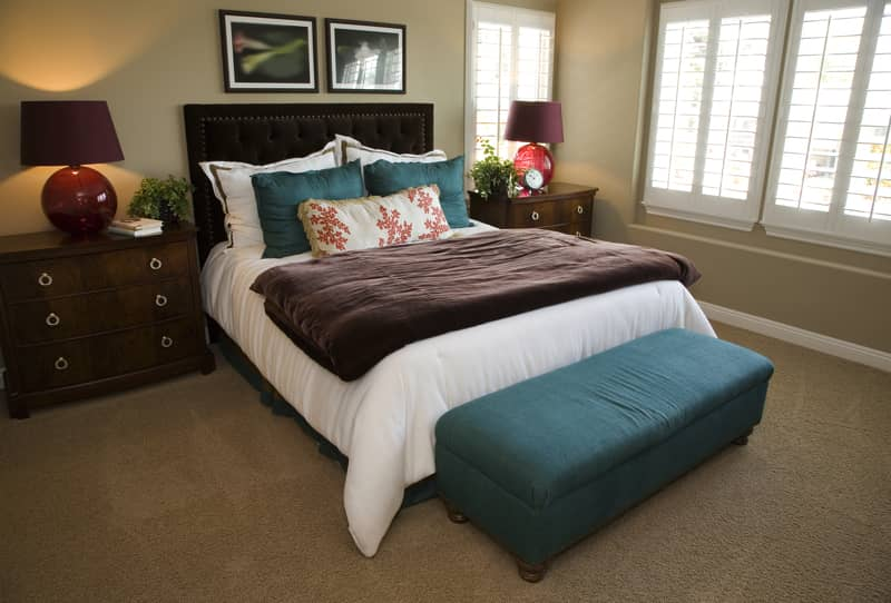 designer master bedroom with simple contrasting color theme