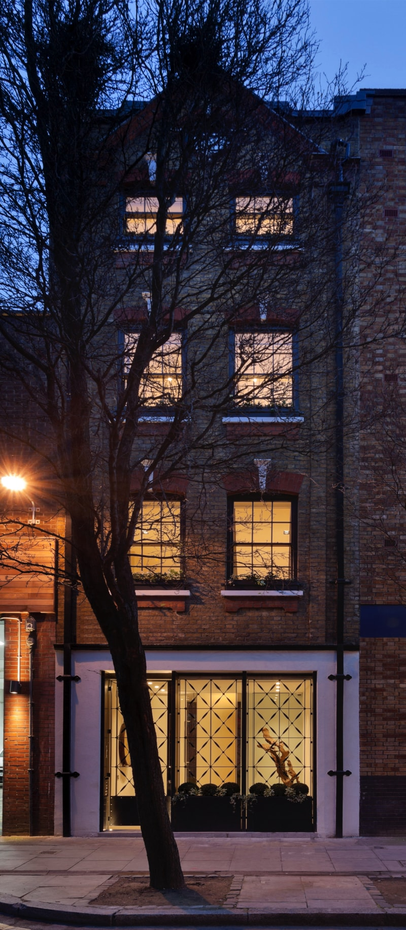 NarrowHouse exterior night shot min - Narrow House Makeover, Covent Garden, London UK by FORMstudio