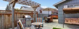 House Backyard With Patio Area House backyard with juacuzzi small patio area and garden swing