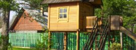 The tree house with a staircase and a slide for the children's games-min