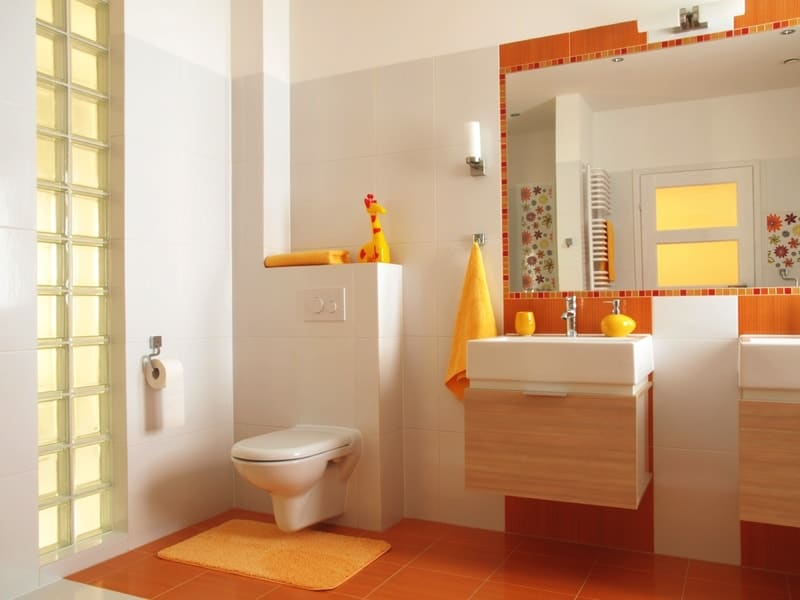 Friendly bathroom for children with orange tiles and flower decors - Modern Bathroom Design Ideas