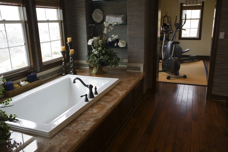 Luxurious bathroom with a modern tub and hardwood floor - Modern Bathroom Design Ideas