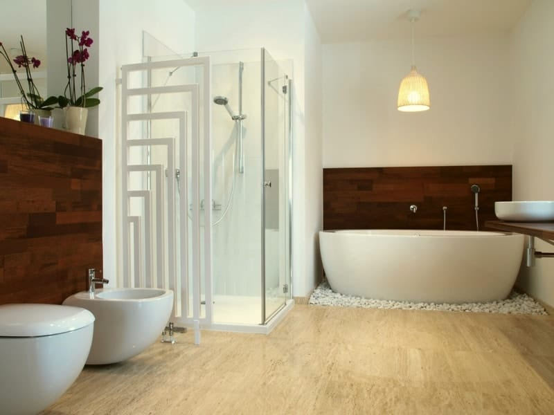 Modern en suite bathroom with free standing bath and travertine tiles - Modern Bathroom Design Ideas