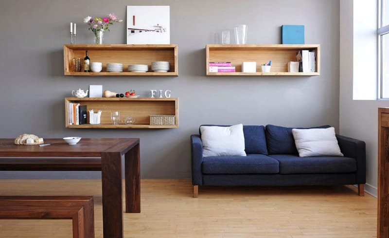 Place Oak Wall Mounted Shelves in Dining Sitting Room with Blue Sofa and Wooden Dining Table min - (Making The Most Of) The Space In Your Tiny House or Apartment