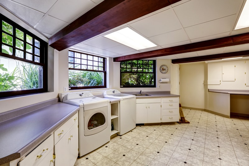 large basement home laundry room with laundry appliances and lots of