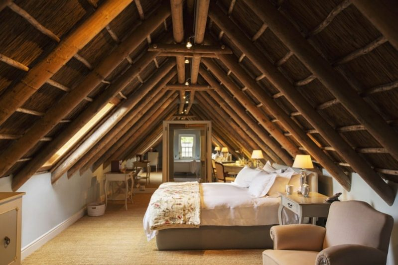 exposed wood attic bedroom