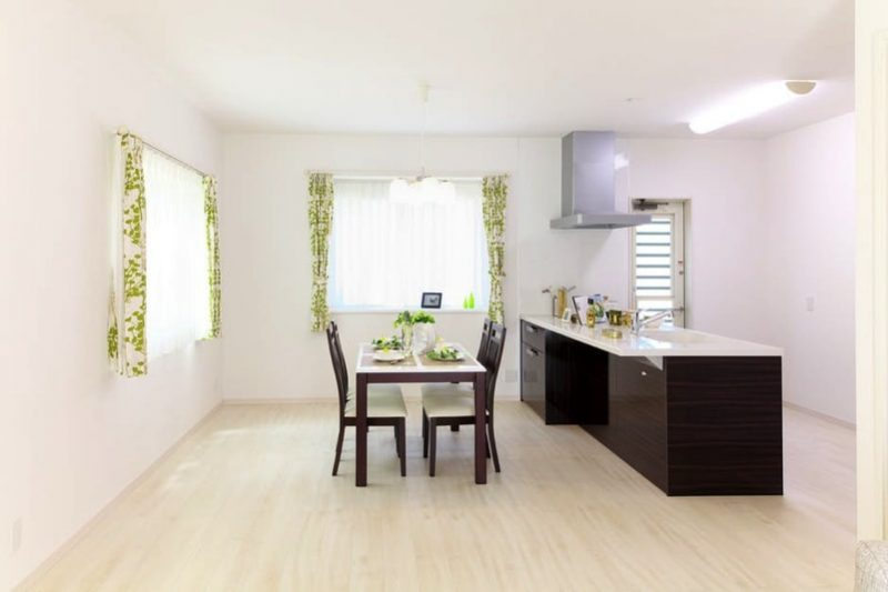 minimalist kitchen and dining with feature curtains