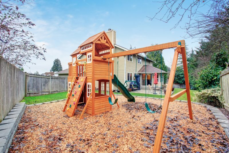 Large backyard with patio and play set e1500698887514 - Childrens' Outdoor Play Equipment