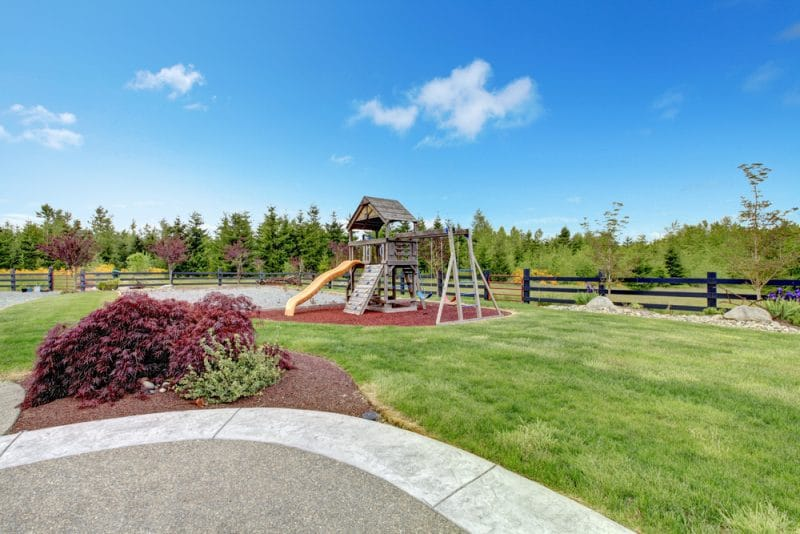 Large luxury home back yard with play ground for kids e1500699659898 - Childrens' Outdoor Play Equipment