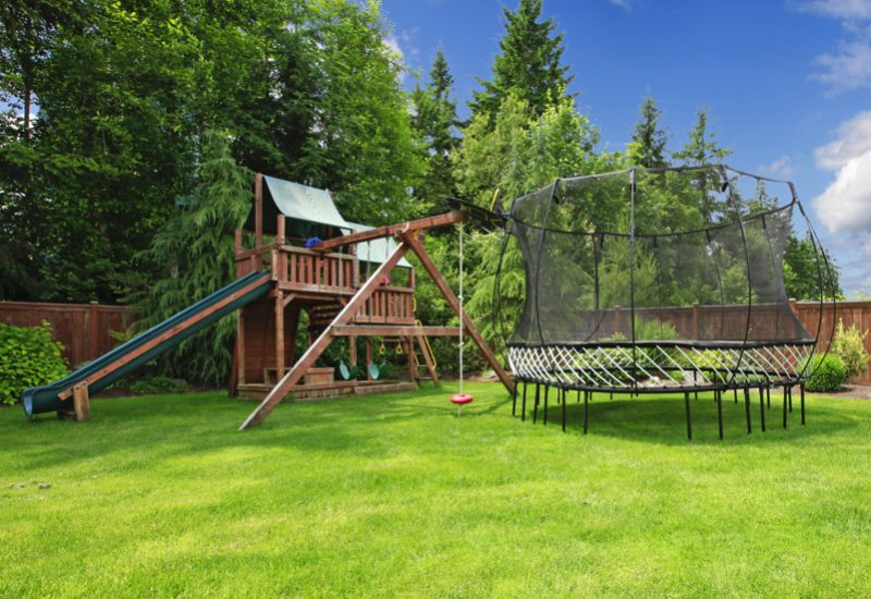 Play kinds ground area with trampling in fenced backyard during summer e1500699821199 - Childrens' Outdoor Play Equipment